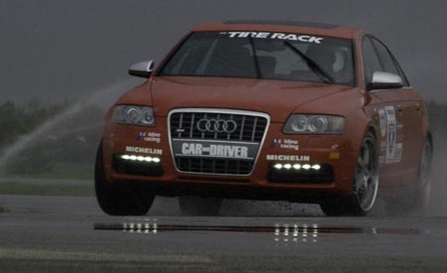 The official C/D ride for 2007 was this Audi S6 sedan. The combination of Quattro all-wheel drive and Michelin Pilot Sport PS2 tires made it a formidable player in damp conditions, such as the wet skidpad kickoff event at Tire Rack where it posted the third best result among 85 contenders. - Slide 1