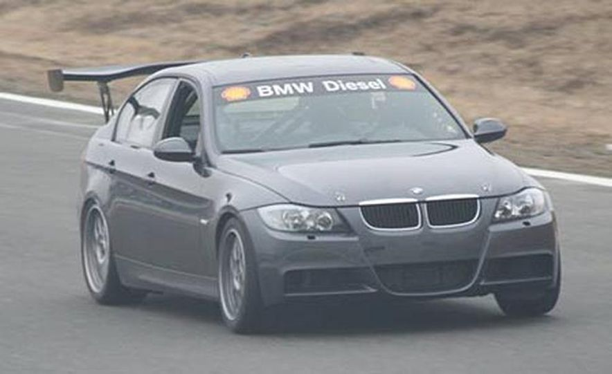 From the outside, the BMW 335d is mostly stock, with the exception of the major rear wing, which was originally designed for a Japanese GT Silhouette racer. For the race, the car will also get a prominent front splitter to balance the downforce produced by the wing. The next time you see the car, it will have a bunch more logos on it as well. - Slide 1
