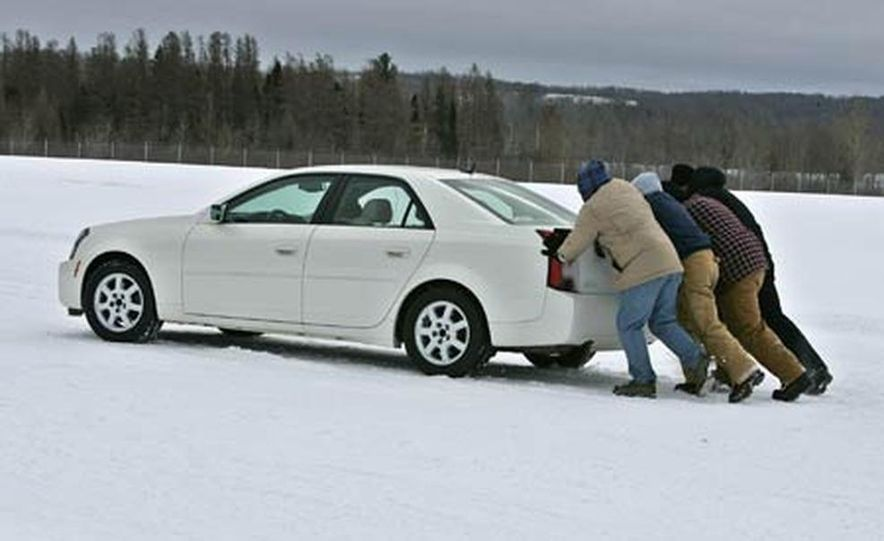 Cadillac CTS during snow testing - Slide 1