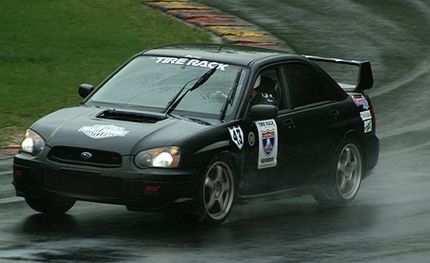 Luke Russell piloted the Top Speed Subaru WRX STi between the raindrops, making the quickest time <br /><br />in both the Friday morning and afternoon sessions. Considering the number of spins, offs, bobbles, <br /><br />fires and mechanical failures today, that&amp;#146;s quite an accomplishment. - Slide 7