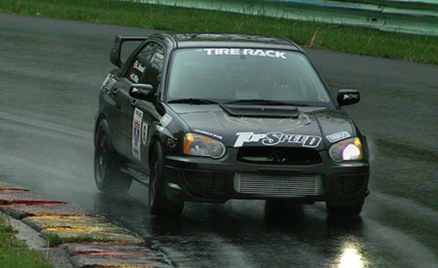 Luke Russell piloted the Top Speed Subaru WRX STi between the raindrops, making the quickest time <br /><br />in both the Friday morning and afternoon sessions. Considering the number of spins, offs, bobbles, <br /><br />fires and mechanical failures today, that&amp;#146;s quite an accomplishment. - Slide 1