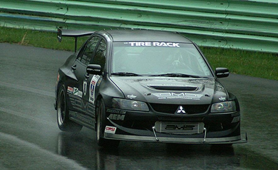 Luke Russell piloted the Top Speed Subaru WRX STi between the raindrops, making the quickest time <br /><br />in both the Friday morning and afternoon sessions. Considering the number of spins, offs, bobbles, <br /><br />fires and mechanical failures today, that&amp;#146;s quite an accomplishment. - Slide 5