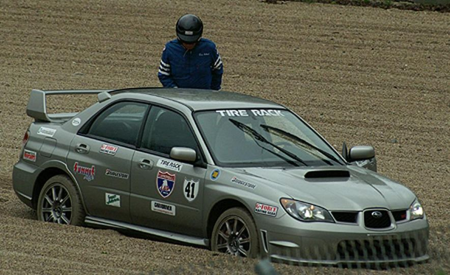 Luke Russell piloted the Top Speed Subaru WRX STi between the raindrops, making the quickest time <br /><br />in both the Friday morning and afternoon sessions. Considering the number of spins, offs, bobbles, <br /><br />fires and mechanical failures today, that&amp;#146;s quite an accomplishment. - Slide 6