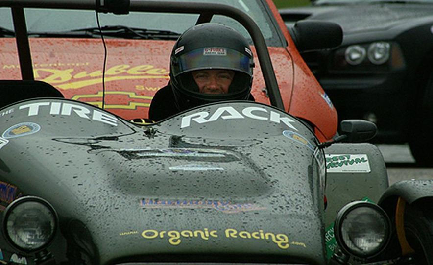 Are we having fun yet? Kevin Boulton smiles despite having driven all night through periods of heavy <br /><br />rain in an open-top Ultralite. The Organic Racing Team&amp;#146;s finishing positions in Thursday&amp;#146;s two time trials <br /><br />illustrate the weather&amp;#146;s topsy-turvy effect on the day&amp;#146;s scores. - Slide 1