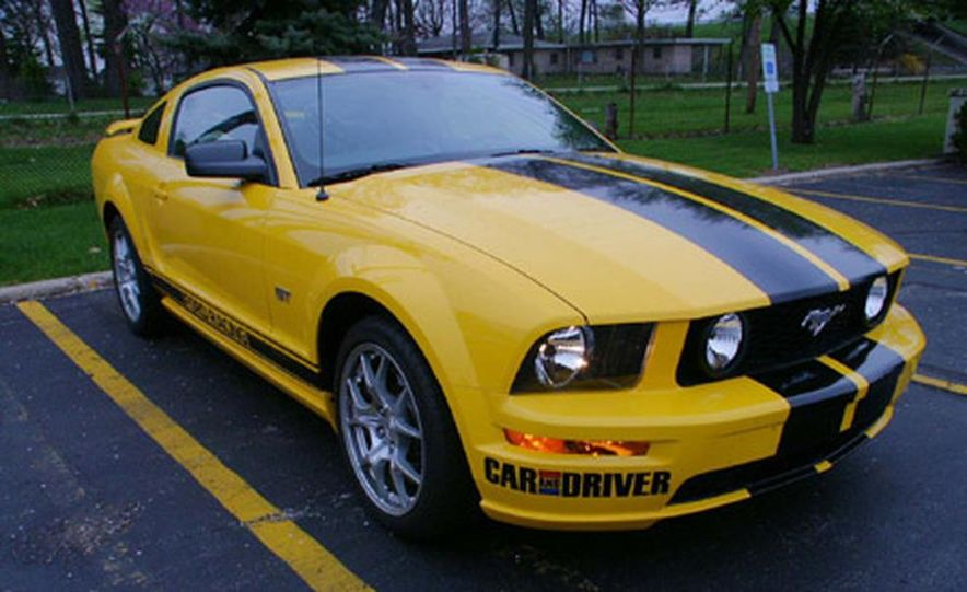 "Car and Driver's official One Lap entry, an '05 Ford Mustang GT in the subdued ""Screaming Yellow"" paint scheme, got a relaxing, pre-race massage from the Ford Special Vehicle team. (Drivers Tony Swan and Mary Seelhorst.) - Slide 1"