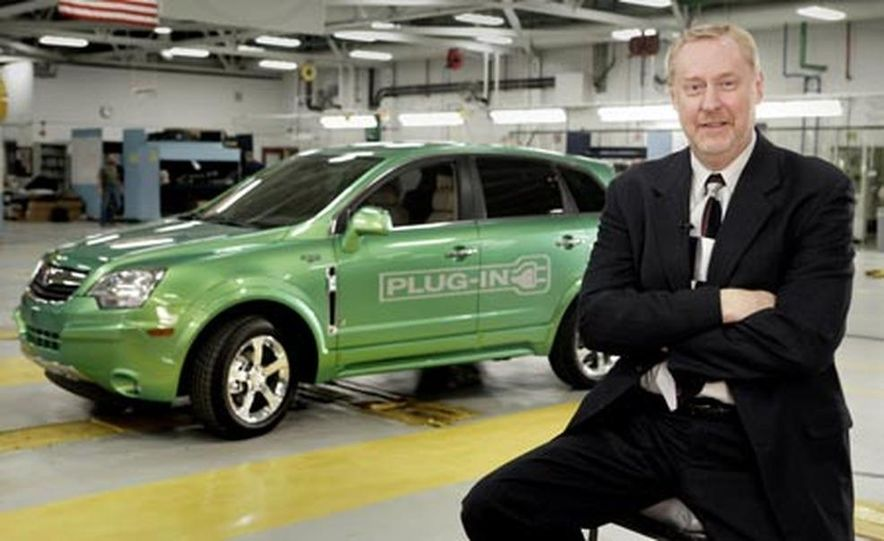 General Motors Group Vice President for GM Powertrain and Quality Tom Stephens with the Saturn Vue Green Line Plug-in hybrid. - Slide 1