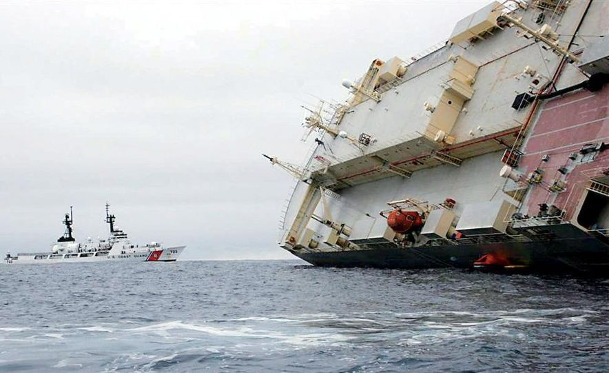 """In July 2006, the """"roll-on/roll-off"""" car carrier Cougar Ace foundered just south of the Aleutian Islands. The U.S. Coast Guard and Alaska Air National Guard got the crew out. The 4703 Mazdas onboard had to wait a good deal longer to be rescued. - Slide 10"""