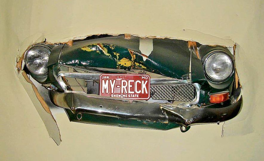 John Mangles' friend managed to put a dead MGB back on its feet—?and then, the first day back on the road, stuffed it. Mangles knew it would be a chick magnet if it was mounted on the wall of his pad. - Slide 1