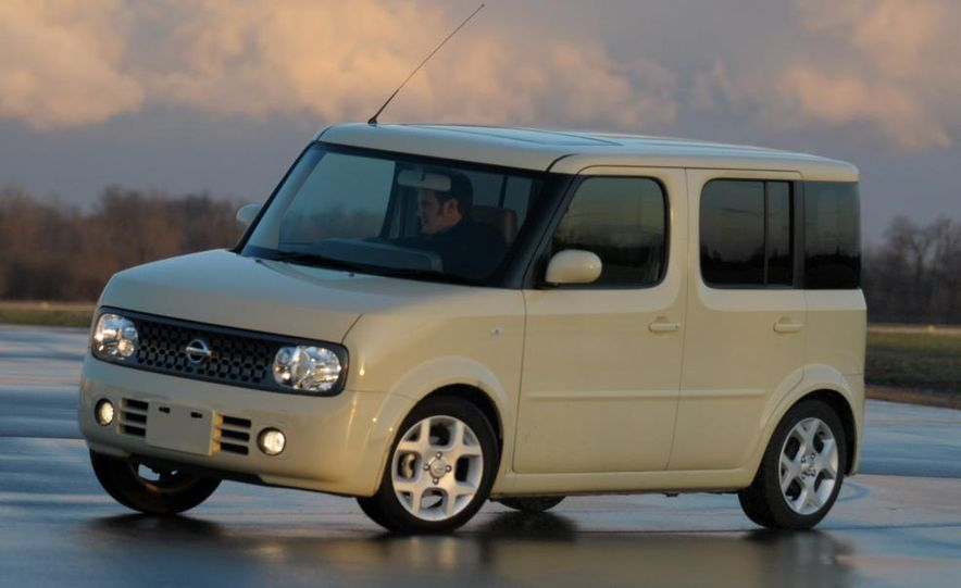Technical Mermaid, Mike Austin, chills in the 2008 Nissan Cube e-4WD (Japanese spec) interior. - Slide 20