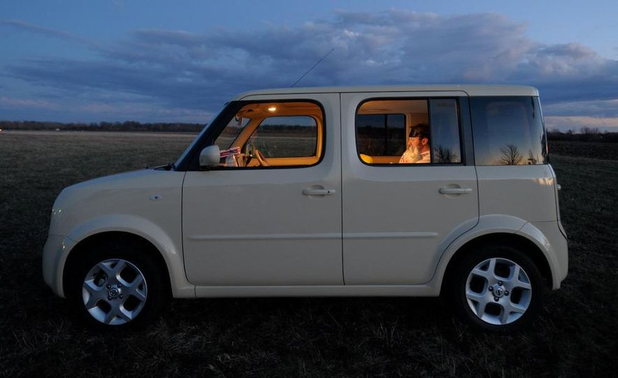 Technical Mermaid, Mike Austin, chills in the 2008 Nissan Cube e-4WD (Japanese spec) interior. - Slide 21