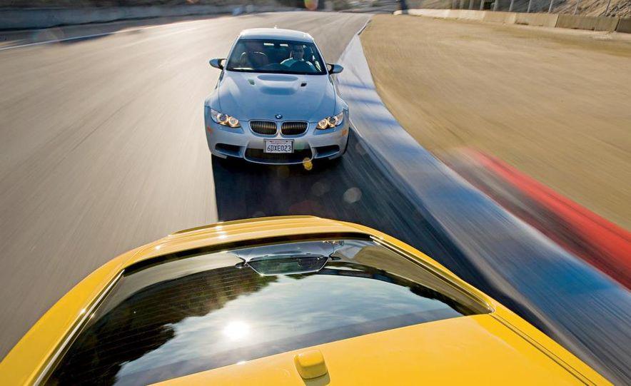 2009 BMW M3 steering-wheel-mounted paddle shifter - Slide 24
