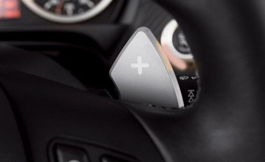 2009 BMW M3 steering-wheel-mounted paddle shifter - Slide 1