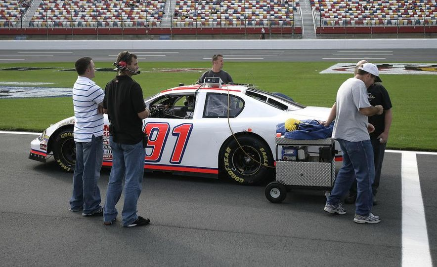 The MSRP Motorsports No. 91 Chevrolet, a start-and-park car, sits on pit road at Lowe's Motor Speedway before qualifying. - Slide 1