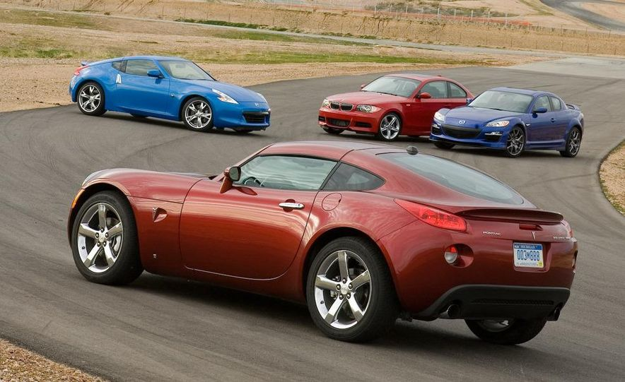 2009 Pontiac Solstice GXP coupe. 2009 Nissan 370Z, 2009 BMW 135i coupe, and 2009 Mazda RX-8 R3 - Slide 3