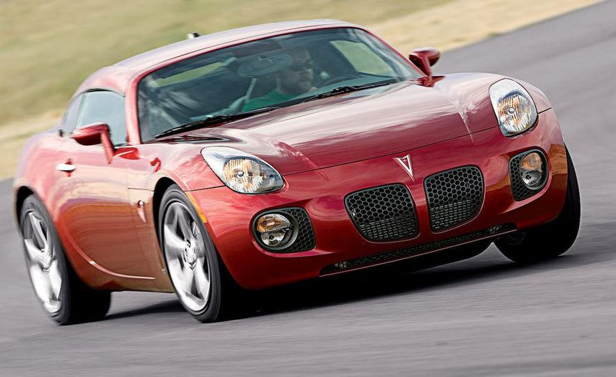 2009 Pontiac Solstice GXP coupe. 2009 Nissan 370Z, 2009 BMW 135i coupe, and 2009 Mazda RX-8 R3 - Slide 4