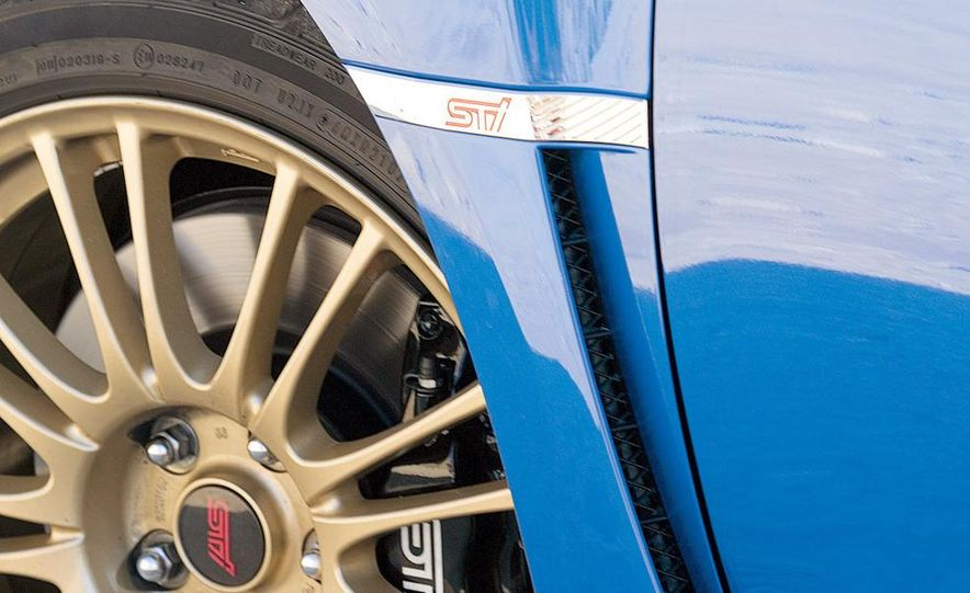 2008 Subaru Impreza WRX STI fender vent and wheel - Slide 1