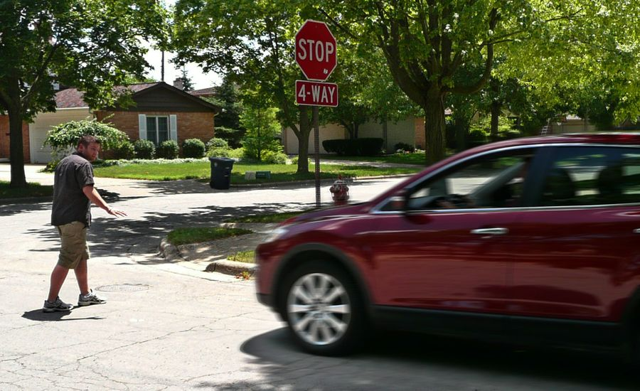 Smart Intersections for Dumb Drivers