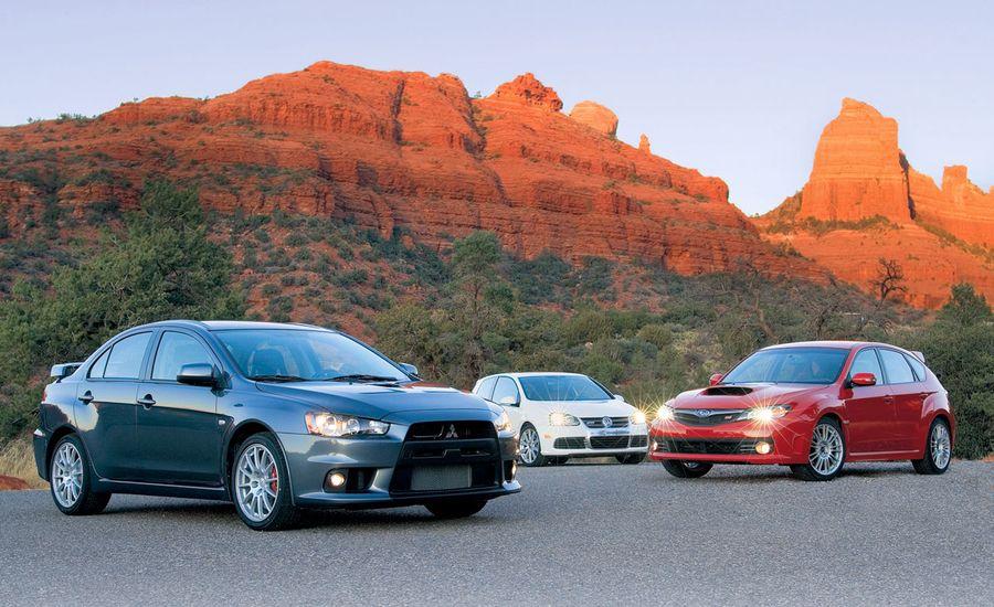 Subaru STI vs. Mitsubishi Evo vs. VW R32