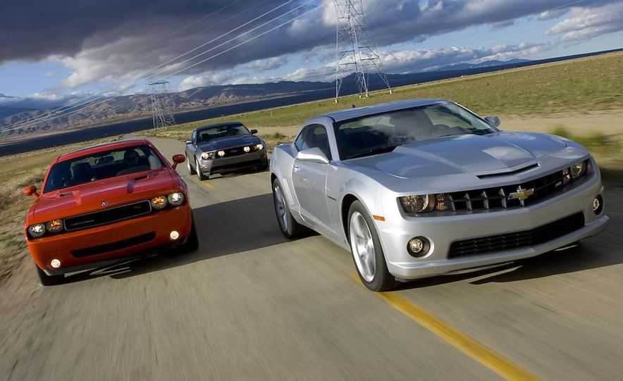 2010 Ford Mustang GT coupe, 2009 Dodge Challenger R/T, and 2010 Chevrolet Camaro SS - Slide 4