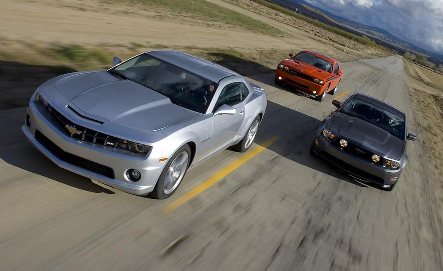 2010 Ford Mustang GT coupe, 2009 Dodge Challenger R/T, and 2010 Chevrolet Camaro SS - Slide 3