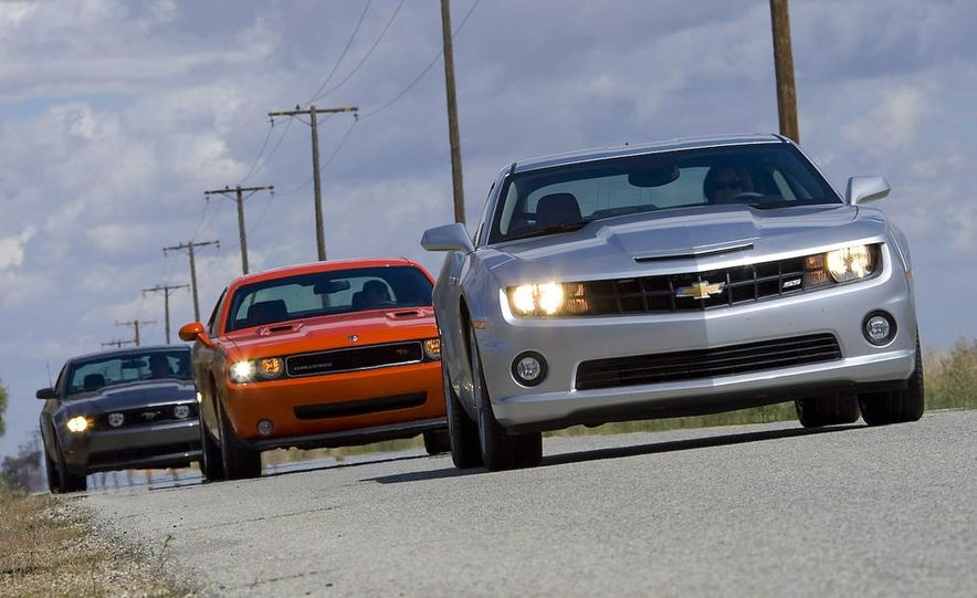 2010 Ford Mustang GT coupe, 2009 Dodge Challenger R/T, and 2010 Chevrolet Camaro SS - Slide 1