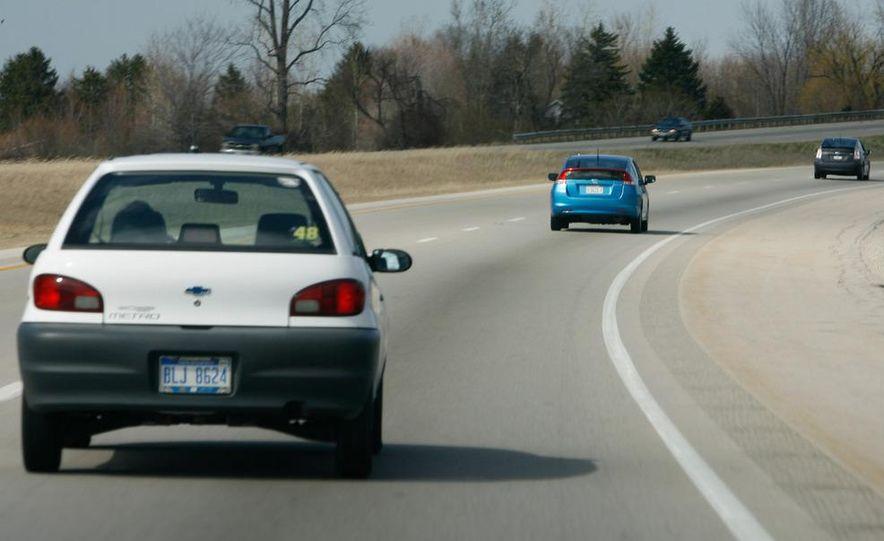 1998 Chevrolet Metro, 2010 Toyota Prius, and 2010 Honda Insight - Slide 3