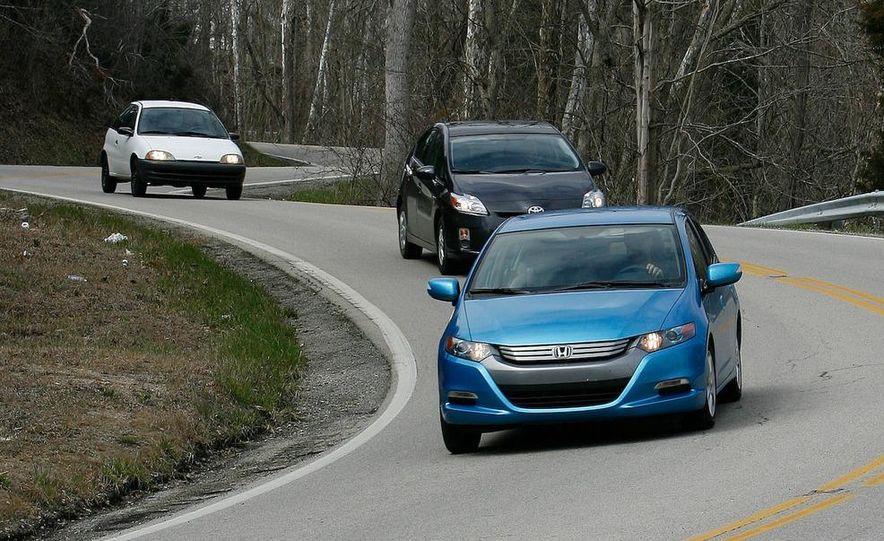 1998 Chevrolet Metro, 2010 Toyota Prius, and 2010 Honda Insight - Slide 1