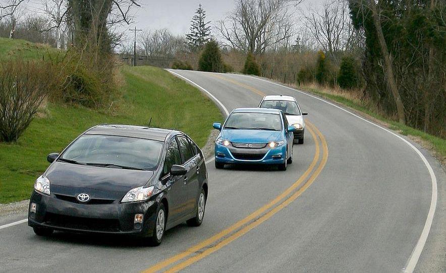 1998 Chevrolet Metro, 2010 Toyota Prius, and 2010 Honda Insight - Slide 2