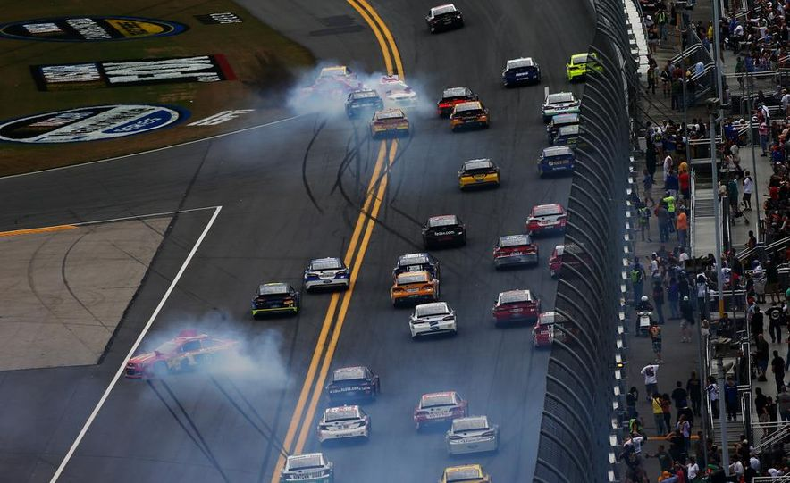 Jimmie Johnson, driver of the #48 Lowe's Chevrolet on the podium at the 2013 Daytona 500. - Slide 7