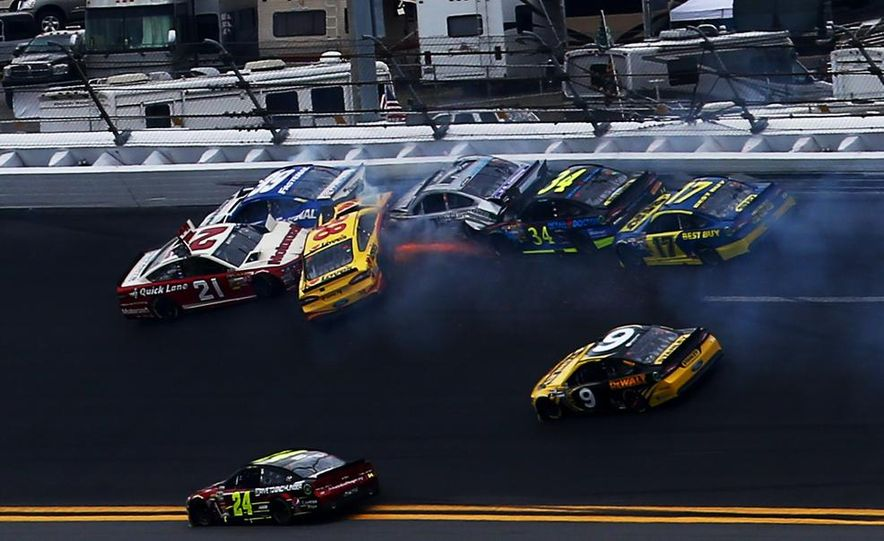 Jimmie Johnson, driver of the #48 Lowe's Chevrolet on the podium at the 2013 Daytona 500. - Slide 11