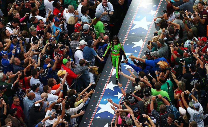 Jimmie Johnson, driver of the #48 Lowe's Chevrolet on the podium at the 2013 Daytona 500. - Slide 14