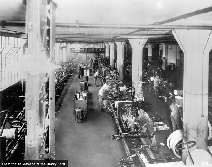 Chassis construction was the final step in Ford's transition from static to moving assembly. This 1914 photo shows in-progress chassis on the line. The moving lines cut the Model T's final assembly time in half, from 12 hours to six. Continual adjustments and refinements kept reducing final assembly time until nearly four more hours were saved.
