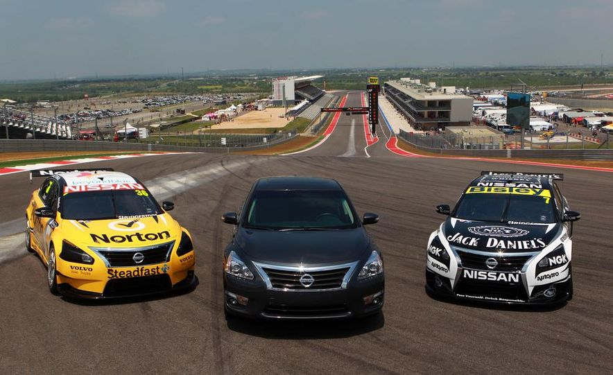 2013 Nissan Altima sedan and race cars at the Circuit of the Americas - Slide 1