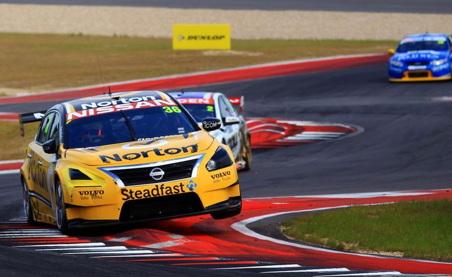 2013 Nissan Altima sedan and race cars at the Circuit of the Americas - Slide 9