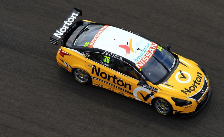 2013 Nissan Altima sedan and race cars at the Circuit of the Americas - Slide 11