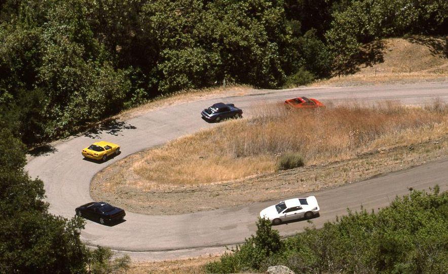 Lotus Esprit Turbo SE, Acura NSX, Chevrolet Corvette ZR-1, Porsche 911 Carrera 4, and Ferrari 348ts - Slide 1