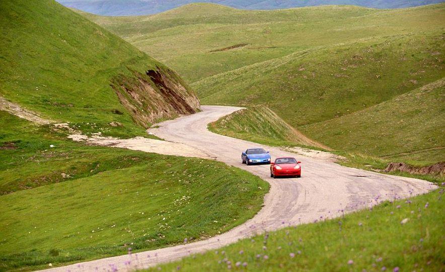 Chevrolet Corvette and Porsche 911 Carrera - Slide 1