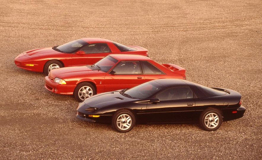 1993 Chevrolet Camaro Z28, 1993 Pontiac Firebird Formula, and 1993 Ford Mustang Cobra - Slide 3