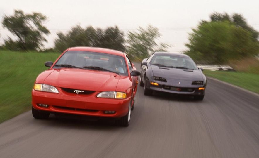 1994 Ford Mustang GT vs. 1994 Chevrolet Camaro Z28 - Slide 1