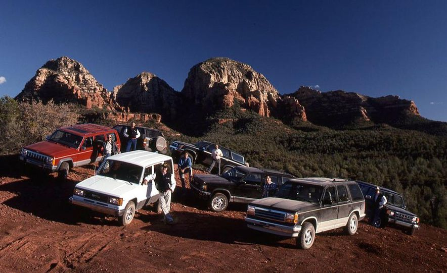 Toyota 4Runner SR5 V6 4WD, Isuzu Trooper LS, Mitsubishi Montero LS, Jeep Cherokee Laredo, Ford Explorer Eddie Bauer, Nissan Pathfinder SE V6, and GMC S-15 Jimmy SLX - Slide 6