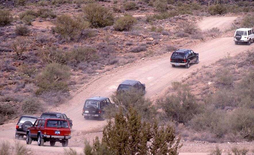 Toyota 4Runner SR5 V6 4WD, Isuzu Trooper LS, Mitsubishi Montero LS, Jeep Cherokee Laredo, Ford Explorer Eddie Bauer, Nissan Pathfinder SE V6, and GMC S-15 Jimmy SLX - Slide 5