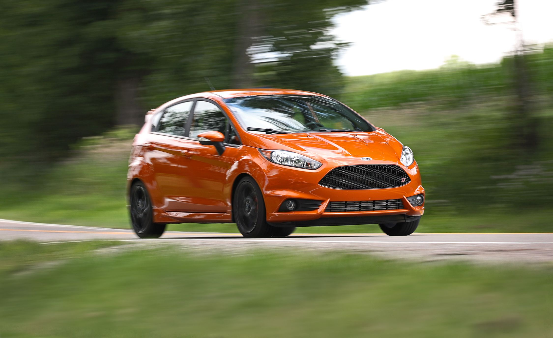 2017 Ford Fiesta St Vs Fiat 500 Abarth Mini Cooper S Hardtop Comparison Test Car And Driver