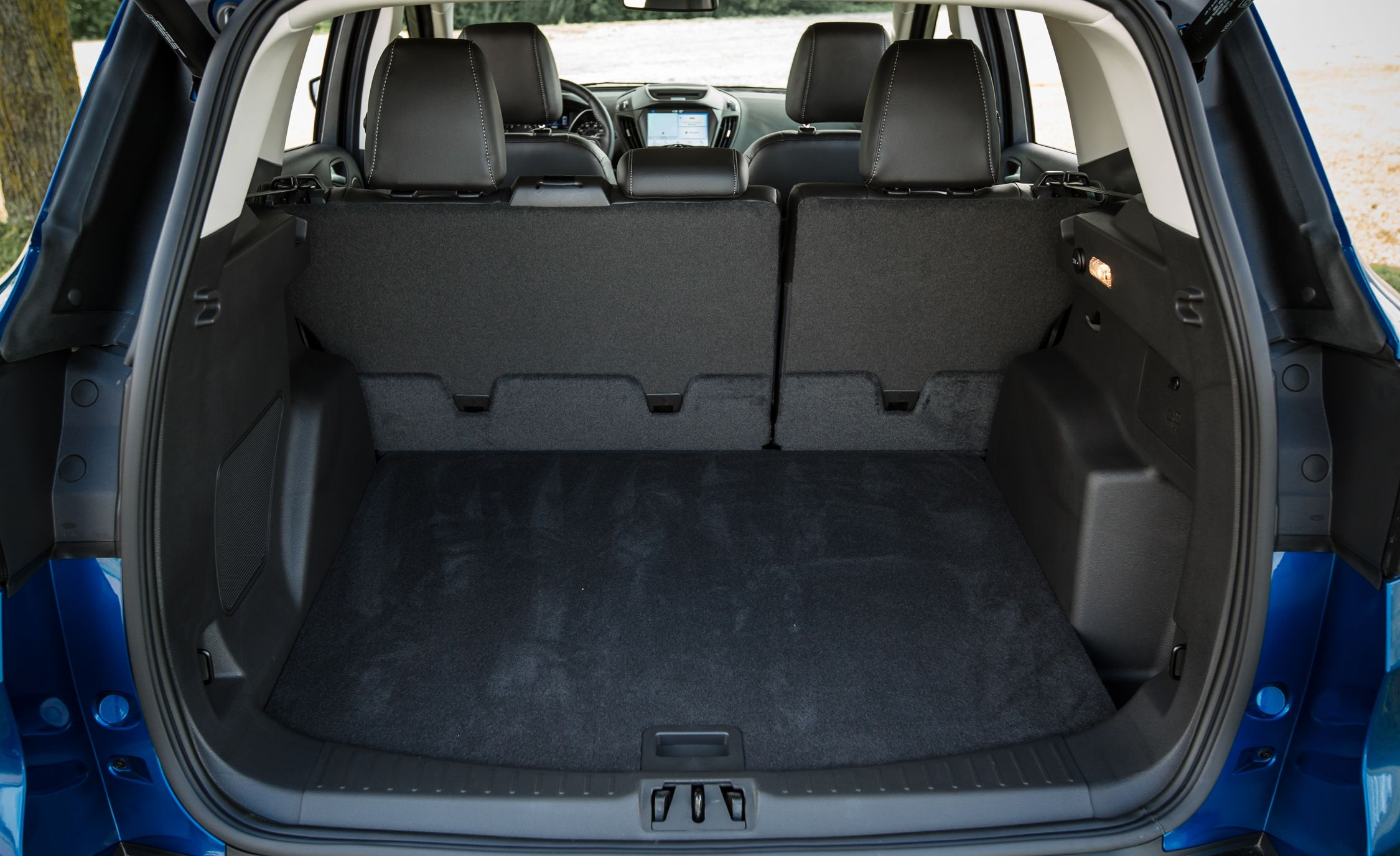 2017 ford escape cargo space and storage review car and driver. Black Bedroom Furniture Sets. Home Design Ideas