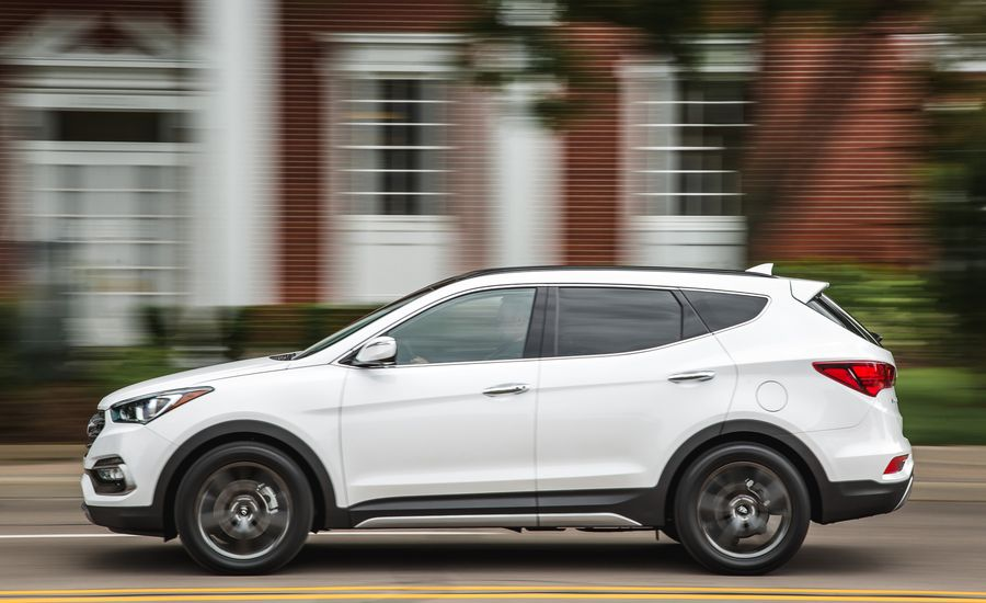 2017 hyundai santa fe sport interior review car and driver for Hyundai santa fe sport interior dimensions