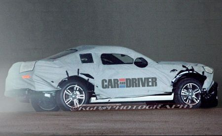 Spied! 2015 Ford Mustang Prototype Caught Under a Very Un-Pretty Cover