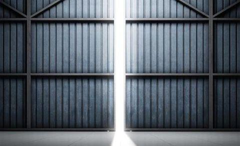 Bugatti Teases High-Performance Hangar Doors—Or Possibly a Car