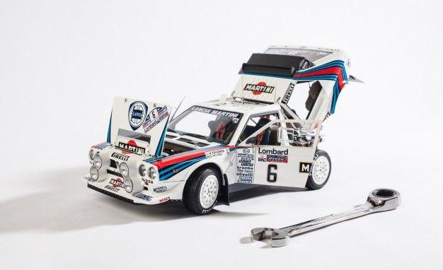 https://hips.hearstapps.com/amv-prod-cad-assets.s3.amazonaws.com/wp-content/uploads/2013/05/AUTOart-1985-Lancia-Delta-S4-rally-car-model-108-626x382.jpg