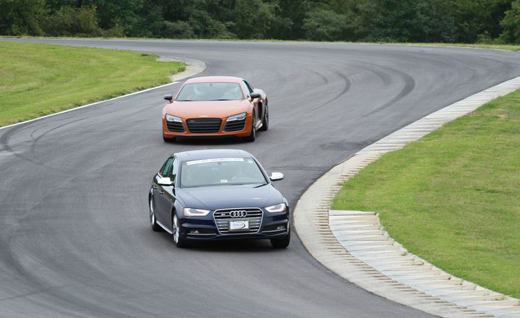 Ride in a Helicopter, Drive an R8, Hang Out with Tom Kristensen at the Primland Driving Experience
