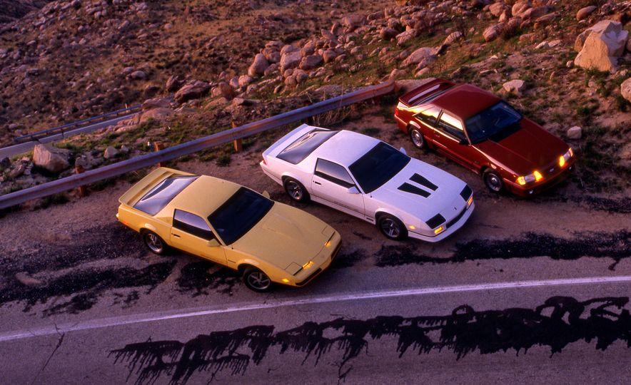 Pontiac Firebird Formula, Chevrolet Camaro IROC-Z, and Ford Mustang GT - Slide 1