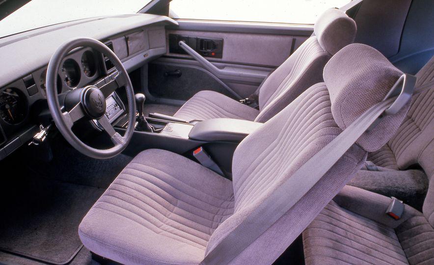 Pontiac Firebird Formula, Chevrolet Camaro IROC-Z, and Ford Mustang GT - Slide 6